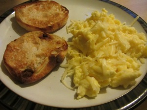 A perfect plate of scrambled eggs, topped with sharp white cheddar.