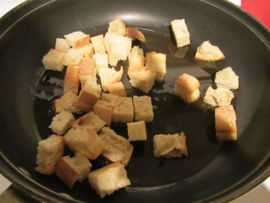Croutons tossed in garlic oil.