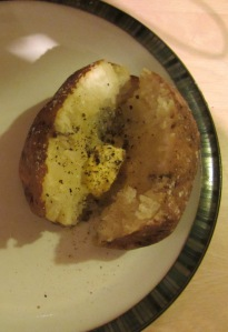 Baked potato with butter, salt, and pepper.