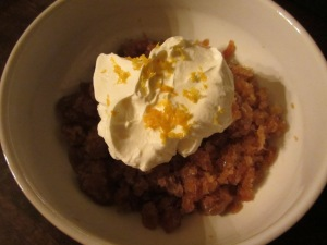 Coffee granita with whipped cream and orange zest.