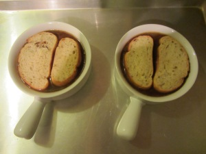 Soup with bread on top.