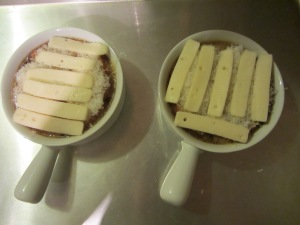 Parmesan and Fontina cheeses on the soup.