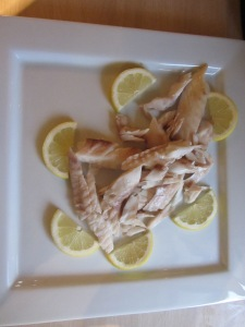 Completed fish, served with lemon.