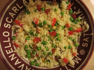 Finished pilaf with peas, golden raisins, and pistachios.