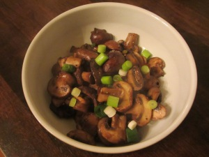Final sauteed mushrooms with chives.