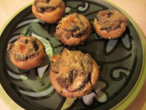 A perfect appetizer plate of stuffed mushroom caps.