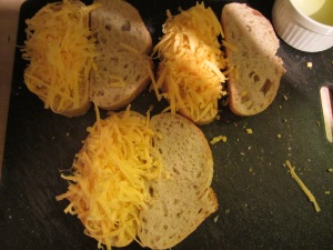 Cheese on the mustard-coated bread.