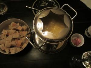 Fondue dinner spread.