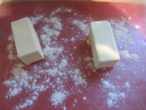 Coating butter in flour.