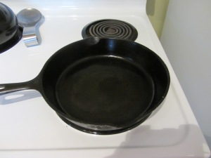 Preheating iron skillet.