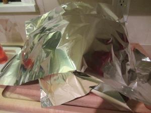 Turkey resting under foil.
