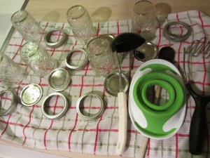 Jars, bands, funnel, masher, and ladle after hand washing.