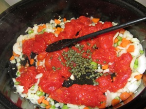 Tomatoes and capers added to vegetables.