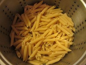 Dry noodles in pot.