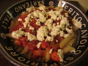 Tomato sauce over penne with goat cheese.