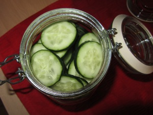 Sliced cucumbers in a jar.