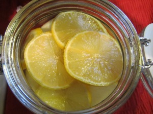 Thinly sliced lemon added to the sliced fruit in the jar.