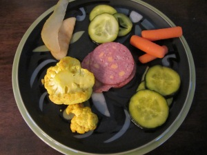 All five types of pickles on a plate, along with some summer sausage. Clockwise from the top:  Kinda Sorta Sours, Firecrackers, AB's B and Bs, Hurry Curry Cauliflower, and Summer Fruits.