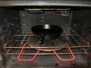 Cast iron skillet heating in the oven.