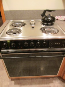 Old range with a broken front burner.