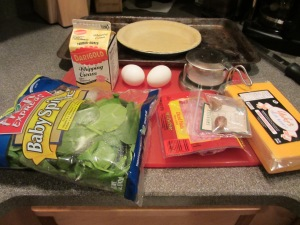 Ingredients:  frozen pie crust, spinach, cream, eggs, cheddar, cubed ham, Kosher salt, nutmeg.