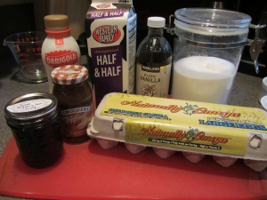 Flan ingredients:  whole milk, half and half, vanilla, sugar, eggs, blueberry jam, and fat-free (doh!) caramel.