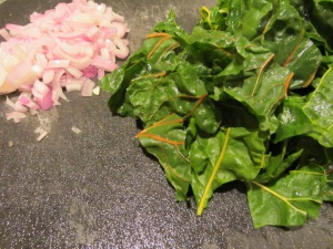 Shallots and shredded chard.