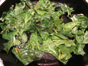 Chard added to hot duck skillet.