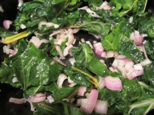Chard and shallots in hot skillet.