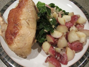 Duck, potatoes cooked in duck fat, and chard.