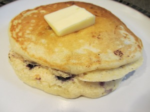 Blueberry pancakes with butter.