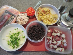 Ingredients for turkey hash:  breakfast sausage, onion, jalapeno, bell pepper, cooked red potatoes, black beans, leftover corn bread pudding, leftover turkey, cayenne, salt, and pepper.
