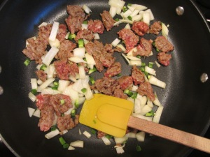 Onion and jalapeno added to pan.