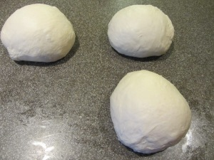Dough portioned into three balls.