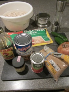 Ingredients for Alton's baked beans:  Great Northern beans, bacon, onion, Jalapenos, tomato paste, brown sugar, molasses, vegetable broth, cayenne pepper, black pepper, and Kosher salt.
