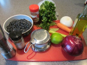Ingredients for black bean salad:  dried black beans, carrot, celery, thyme, parsley, bay leaf, onion, olive oil, lime juice, red onion, cilantro, cumin, chili powder, Kosher salt, and black pepper.