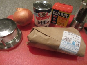 Ingredients for catfish au lait:  evaporated milk, Old Bay Seasoning, black pepper, Kosher salt, onion, and catfish fillets.