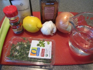 Ingredients for court bouillon:  water, white wine, lemon juice, onion, celery, garlic, black peppercorns, fresh thyme, and bay leaves.