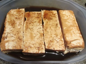 Tofu fillets flipped to marinate for 15 minutes on side two.