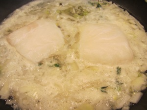 Beautiful sea bass fillets added to the simmering court bouillon.