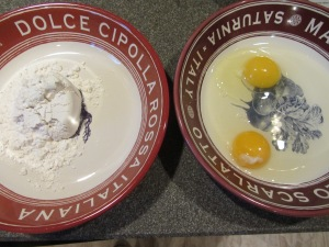 Two dredging dishes:  one with flour and one with eggs.