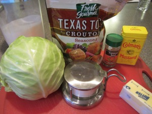 Ingredients:  butter, seasoned croutons, dry mustard, caraway seed, green cabbage, Kosher salt, and sugar.