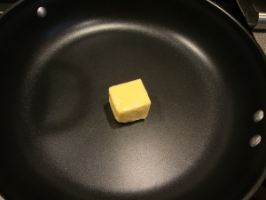 Half a stick of butter in a large skillet.