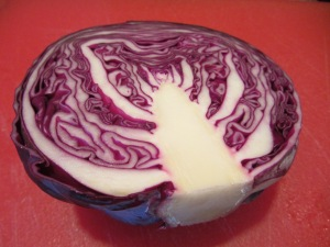 Cabbage halved, and ready to be shredded.