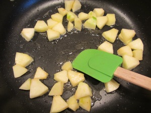 Granny Smith apple added to the pan.