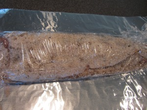 Fillets wrapped tightly in plastic wrap.