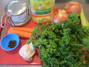 Ingredients for Alton's beef broth:  Kosher salt, canola oil, onions, black peppercorns, garlic, carrots, parsley, and celery. Not pictured:  beef pieces and water.