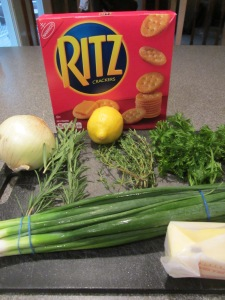 Ingredients for stuffed lobster:  Ritz crackers, onion, lemon, thyme, rosemary, parsley, scallions, and butter.