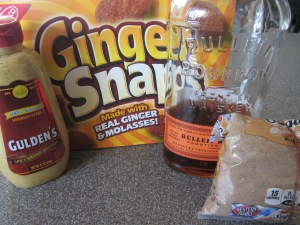 Ingredients for Alton's ham crust:  mustard, gingersnaps, bourbon, and dark brown sugar.
