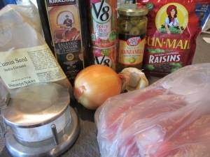 Ingredients for Alton's pot roast:  2 pound blade chuck roast, Kosher salt, cumin, balsamic vinegar, tomato juice, onion, garlic, green olives, and dark raisins.